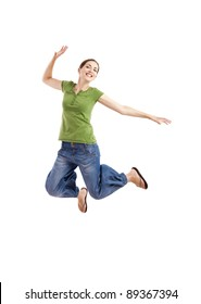 Beautiful happy woman jumping over a white background