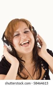 beautiful happy woman listening to music