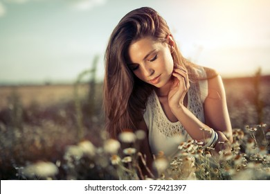 Beautiful happy woman outdoors in countryside