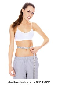 Beautiful happy woman with perfect body measuring waist with measurement tape, isolated on white.