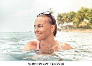 Beautiful happy woman sea tropical beach portrait summer vacation holidays lifestyle
