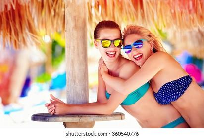 beautiful happy women, friends enjoy summer vacation on tropical beach