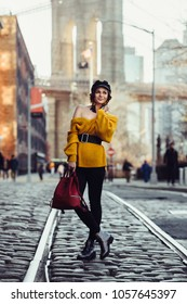 Beautiful happy young fashionable woman traveling in New York City with backpack. Tourists Lifestyle travel concept.