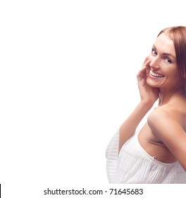 beautiful happy young laughing woman, looking up, a lot of copy space to the left