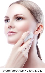 Beautiful happy young model woman face with hands near chin remove beauty makeup. Natural nude makeup, green eyes, blond hair, clean skin. Facial treatment skincare health concept