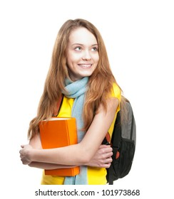 Beautiful and happy young student girl holding book. Backpack on her shoulders. Looking away from the camera and smiling. Isolated on white background.
