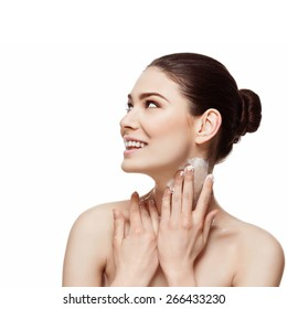 Beautiful happy young woman applying moisturizing cream on her neck. Beauty image. Copy space. Square composition. Isolated over white background.