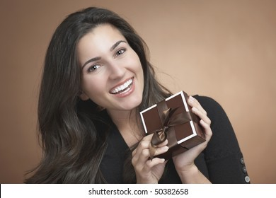 Beautiful happy young woman with birthday gift box