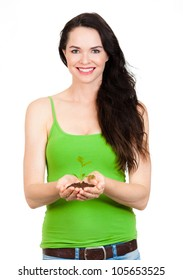 A beautiful happy young woman holding a seedling in her hands. Isolated on white.