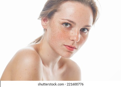 beautiful  happy young woman portrait face  with freckles and smile