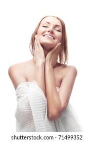 beautiful happy young woman touching her face