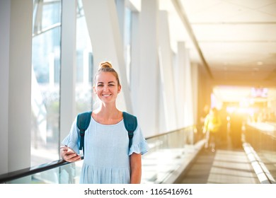 Beautiful happy young woman traveling in metro