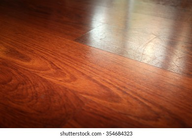 Beautiful Hard Wood Flooring with reflections from a window.