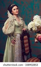 beautiful haughty queen in royal dress.