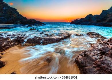 Beautiful Hawaiian colors of a sunrise at Eternity Beach in Honolulu