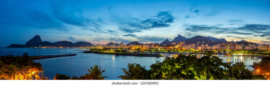 Beautiful HDR panoramic view of the city of Rio de Janeiro with sugar loaf and corcovado at dusk.