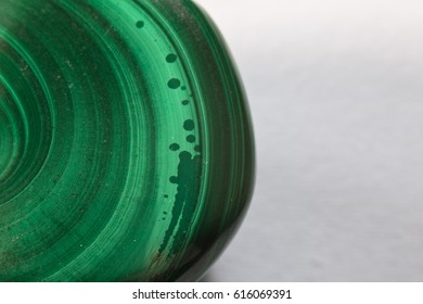 beautiful healing semiprecious green mineral malachite gemstone on white background macro close up with copy space