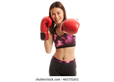 Beautiful healthy Asian girl with red boxing glove  isolated on white background.