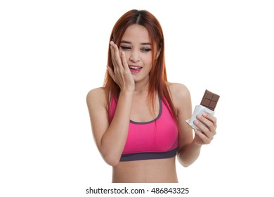 Beautiful  healthy Asian girl very happy with chocolate  isolated on white background.