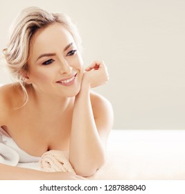 Beautiful and healthy blond woman getting spa therapy and massaging treatments.