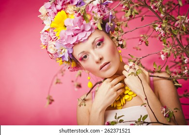 Beautiful healthy girl with spring flowers crown