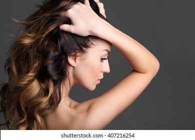 Beautiful healthy hair. Portrait of a woman with beautiful long hair on a black background