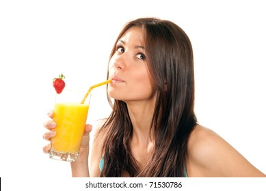 Beautiful Healthy lifestyle brunette woman drinking orange juice cocktail with strawberry with drinking straw in highball glass and looking up isolated on a white background