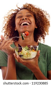 Beautiful healthy mixed Black Hispanic / Latin woman eating a fresh healthy salad isolated over white background