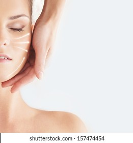 Beautiful, healthy and young woman is getting spa treatment (concept with the arrows)