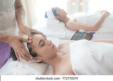 beautiful and healthy young woman relaxing with face massage  at beauty spa salon