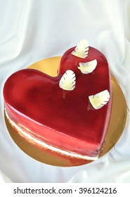 Beautiful heart-shaped cake decorated with chocolate feathers