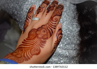 Beautiful henna design on hands. Engagement ring on a hand. Hand isolated.