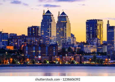 Beautiful high buildings, skyscrapers and towers of the Dnepr city on the Dnieper River illuminated by the setting sun at sunset in the evening. Dnipropetrovsk   Dnipro, Dnepropetrovsk,