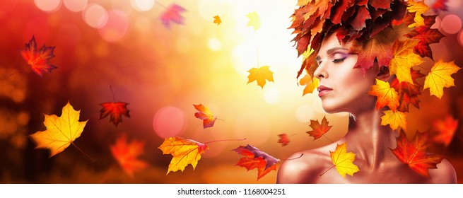 Beautiful High Fashion Woman In Autumn With Falling Leaves Over Nature Background