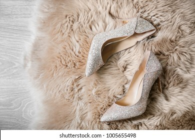 Beautiful high heeled shoes on furry rug