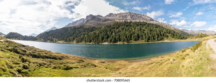 Beautiful high resolution panorama of the Lake Obersee located on the mountain pass Staller Sattel on the border of Austria and Italy with the Riesenferner mountain range in the background.