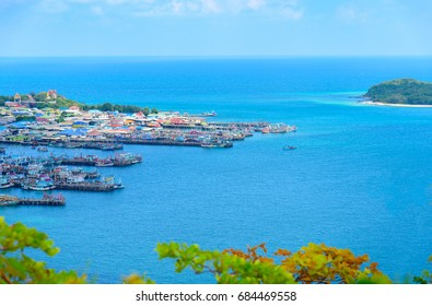 Beautiful high view of seashore village on sunny day with bright clear blue sky background.