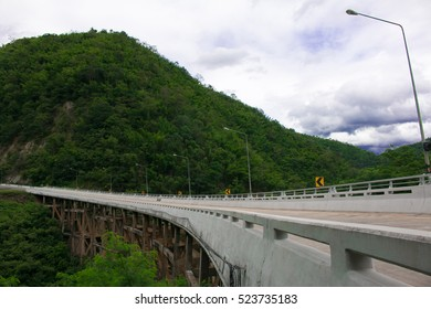 Beautiful highway bridge to the green mountain