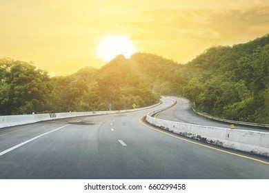 Beautiful highway road of Thailand with green mountain and sun shine background