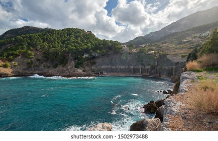 Beautiful hillside Banyalbufar town bay of Mediterranean Sea west coast of Mallorca. Surrounded by Tramuntana mountains district nestles among smaller peaks, where scattered farms and vineyards. Spain