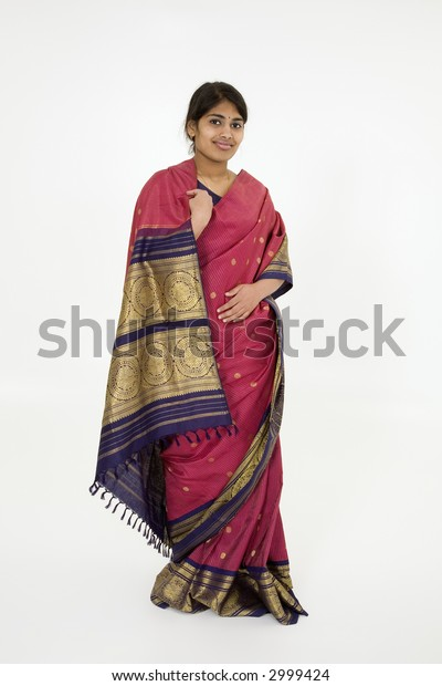 Beautiful Hindu teenager dressed in a traditional Sari dress