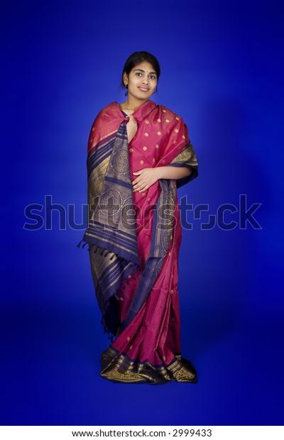 Beautiful Hindu teenager dressed in a traditional Sari dress