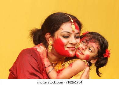Beautiful hindu woman play with vermilion during Sindur Khela traditional ceremony on the final day of Durga Puja festival