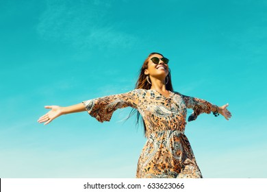Beautiful hippie girl with copy space in blue sky outdoor in summer