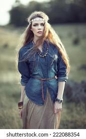 Beautiful hippie girl on nature. Boho fashion style