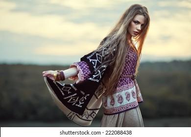 Beautiful hippie girl outdoors at sunset. Boho fashion style