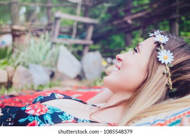 Beautiful hipster girl lying in the garden