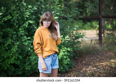 Beautiful hipster girl posing  in the park