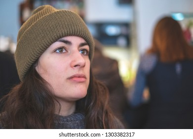 Beautiful hipster student woman looking into the distance, thinking about life.