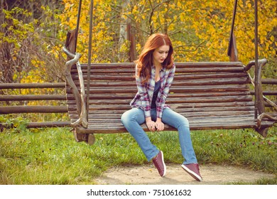 Beautiful hipster traveler with around autumn trees in woods. Stylish woman hiking. adventure and travel concept or rest at weekend on a nature, atmospheric moment